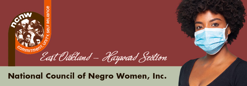 website header with black woman with natural hair wearing a blue mask